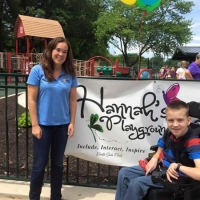 Unlimited Play Founder Natalie Blakemore celebrates another playground opening with her son and inspiration, Zachary.