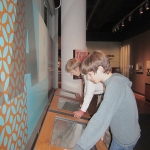 Museum exhibits introduce young visitors to the process of songwriting.