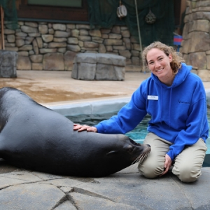 Bennie, a California sea lion, poses with Olstad.