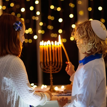 Share in a traditional lighting of the menorah at the Missouri Botanical Garden.